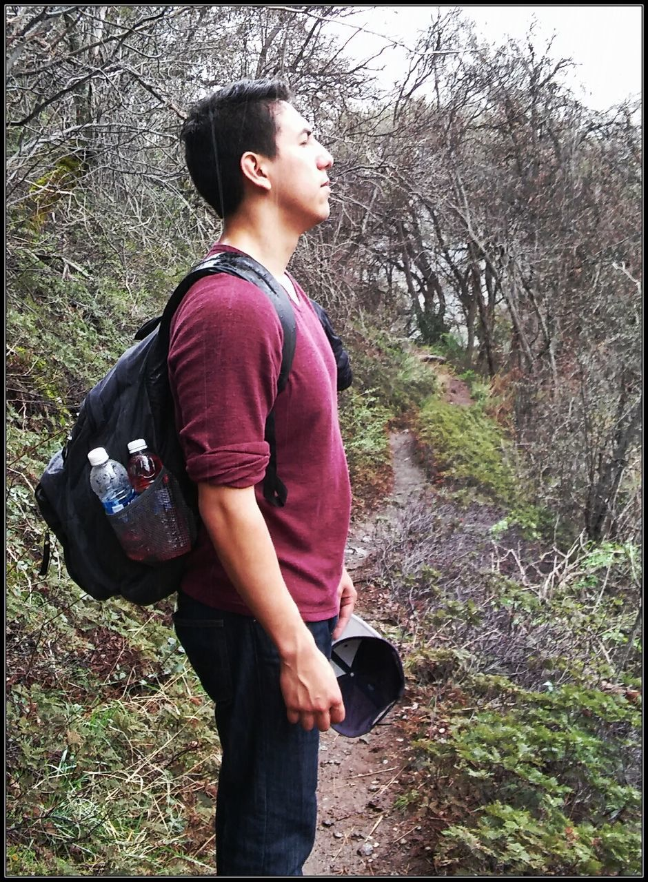 real people, one person, tree, forest, leisure activity, casual clothing, lifestyles, outdoors, side view, nature, day, young adult, standing, young men, beauty in nature, full length