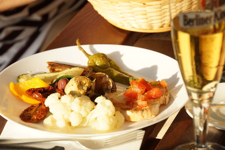 Antipasti Freddi Aperitivoitaliano Beer Glass Half Full Bruschetta Close-up Of Food Food And Drink Germans And Italians Italian Aperitivo In Berlin No People Ready-to-eat Vegetables On A Plate White Plate With Food Wooden Table Set Italian Food Photography