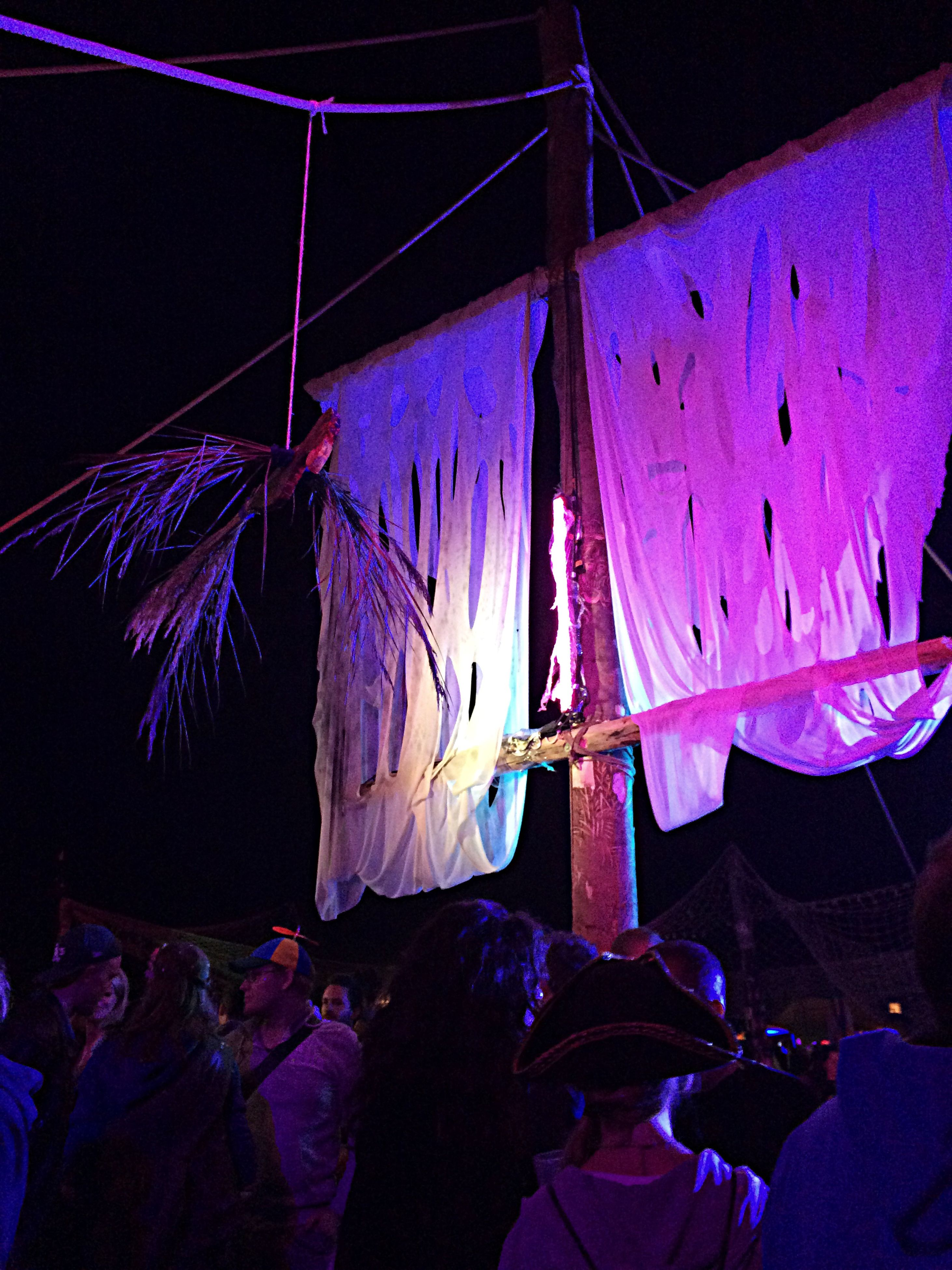arts culture and entertainment, night, multi colored, low angle view, illuminated, blue, outdoors, purple, umbrella, colorful, creativity, no people, sky, hanging, graffiti, rope, built structure, art and craft