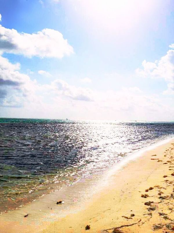 Sea Beach Sand Sky Horizon Over Water Wave Outdoors Scenics Cloud - Sky Water Day No People Beauty In Nature Nature Tide Vacations Sun Streaks Sunbeam
