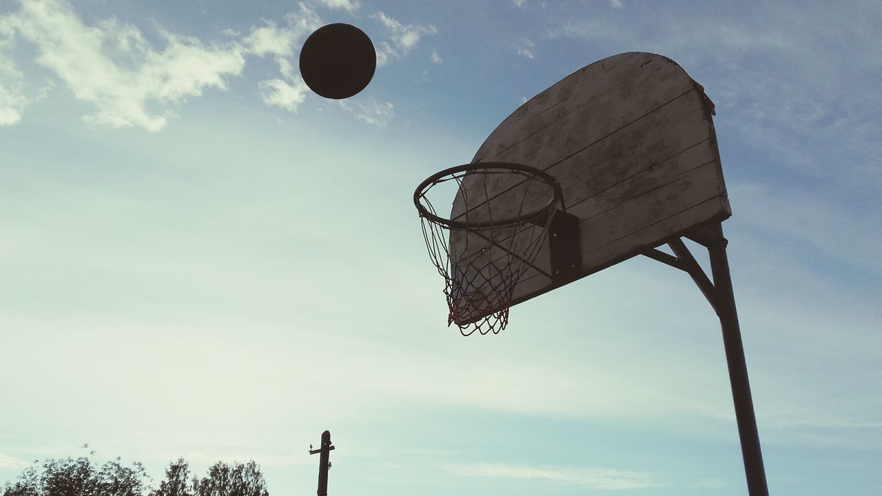 basketball hoop, basketball - sport, basketball, sport, sky, ball, low angle view, cloud - sky, day, net - sports equipment, outdoors, court, no people, nature
