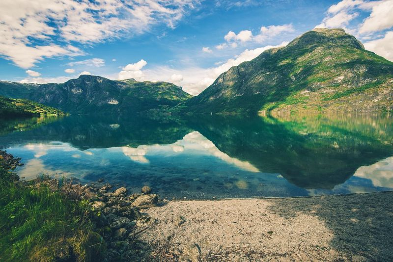 Scenic Norwegian Fjord Landscape in the Summer. Stryn, Norway. Norway Scenic Bay Beauty In Nature Day Fjord Lake Landscape Mountain Mountain Range Nature No People Norwegian Ocean Outdoors Physical Geography Scenics Sky Stryn Tranquil Scene Tranquility Tree Water