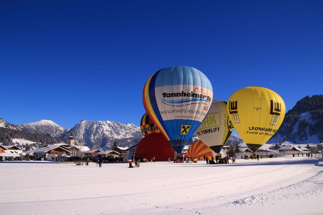 Blue Travel Destinations City Snow Winter Cityscape Night Architecture Outdoors People Ballons Ballonfestival Tannheimer Tal Sport Ballooning Festival Hot Air Balloon