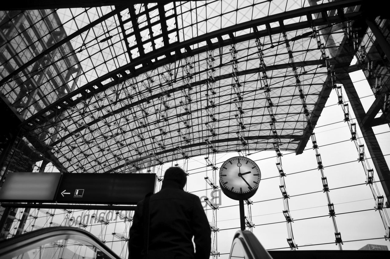 The challenge of seeing a photo opportunity unravel itself. Rushing to get the camera out and ready before you get to the end of the escalator, before the opportunity is lost. Berlin Hauptbahnhof (Train Station) Behind Berlin Berlin Hauptbahnhof City City City Life Clock Curves Escalator Germany GERMANY🇩🇪DEUTSCHERLAND@ International Landmark Lines Public Public Transportation Rear View Shadow Silhouette Standing Tourism Travel Travel Destinations Traveling Urban Monochrome Photography Welcome To Black
