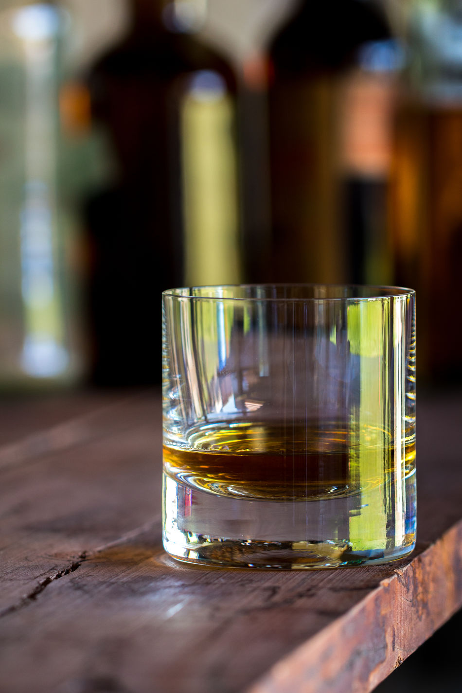 Drinking Glass Drink No People Close-up Alcohol Whiskey Bottles Bar Table Wood Barrel Status GLAMOR