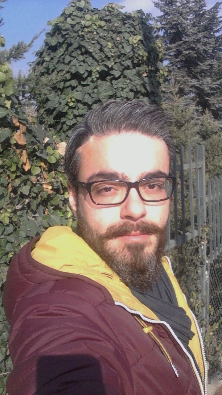 beard, portrait, looking at camera, eyeglasses, one person, outdoors, day, real people, casual clothing, front view, lifestyles, tree, young adult, close-up, nature, people