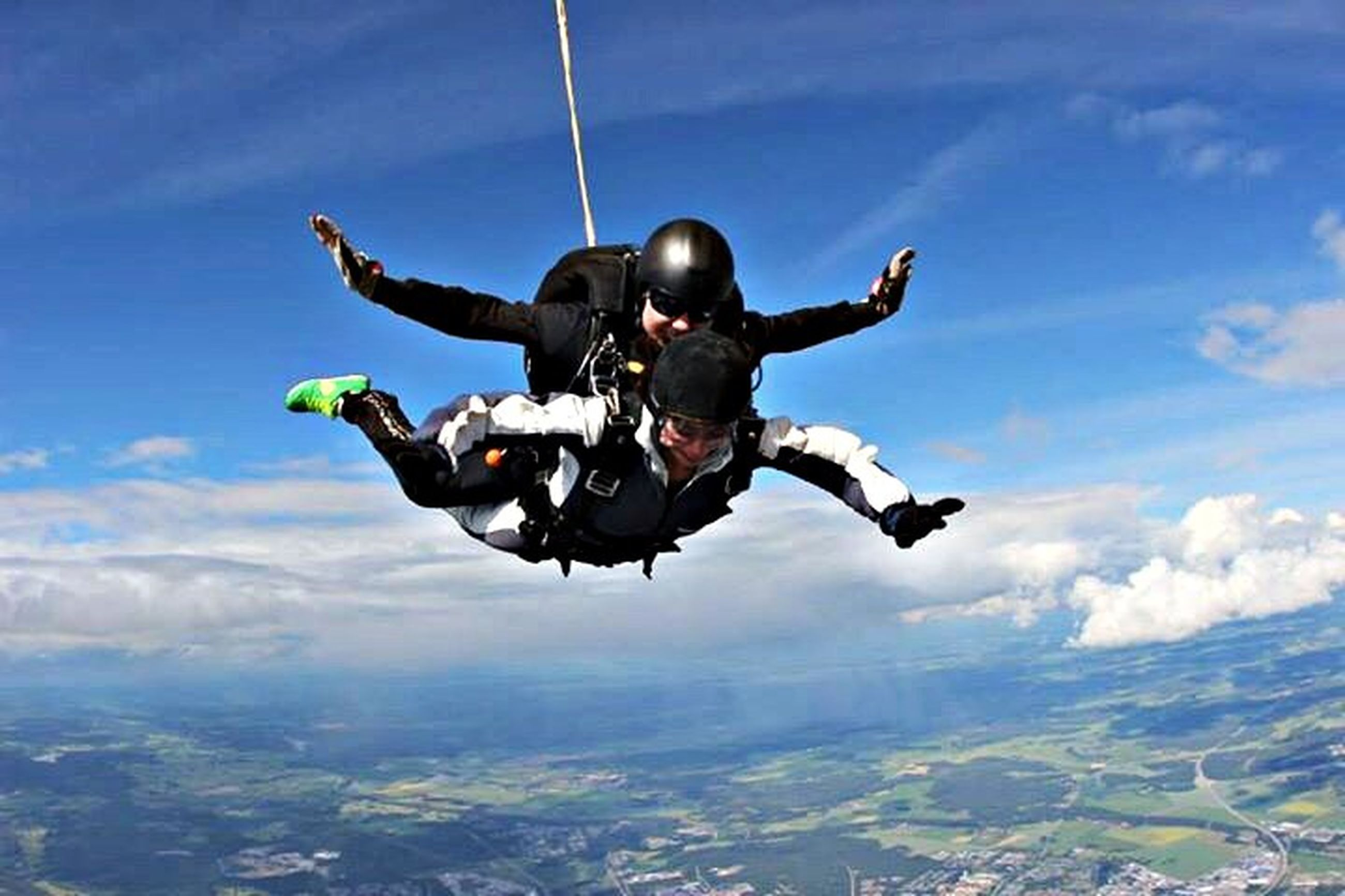 mid-air, sky, leisure activity, low angle view, lifestyles, extreme sports, adventure, cloud - sky, full length, fun, men, sport, freedom, flying, skill, enjoyment, jumping, travel, transportation
