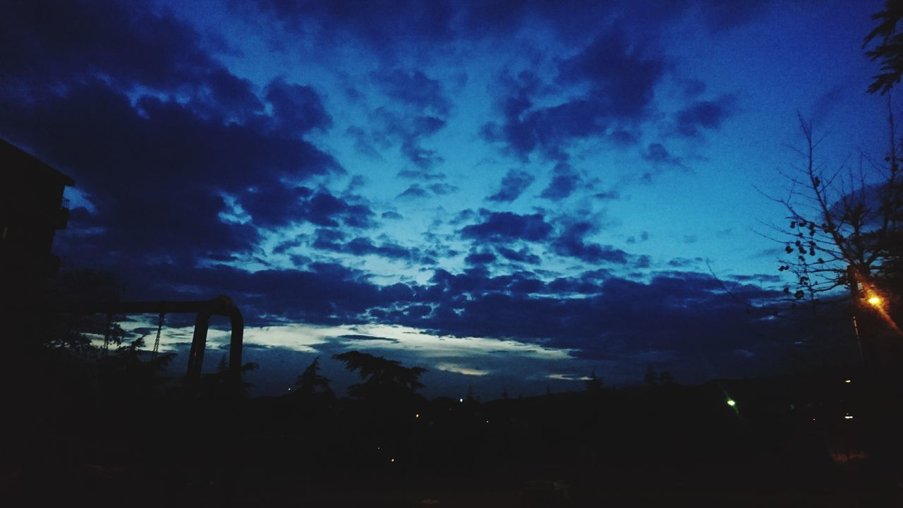 sky, night, nature, cloud - sky, silhouette, beauty in nature, no people, outdoors, scenics, low angle view, illuminated