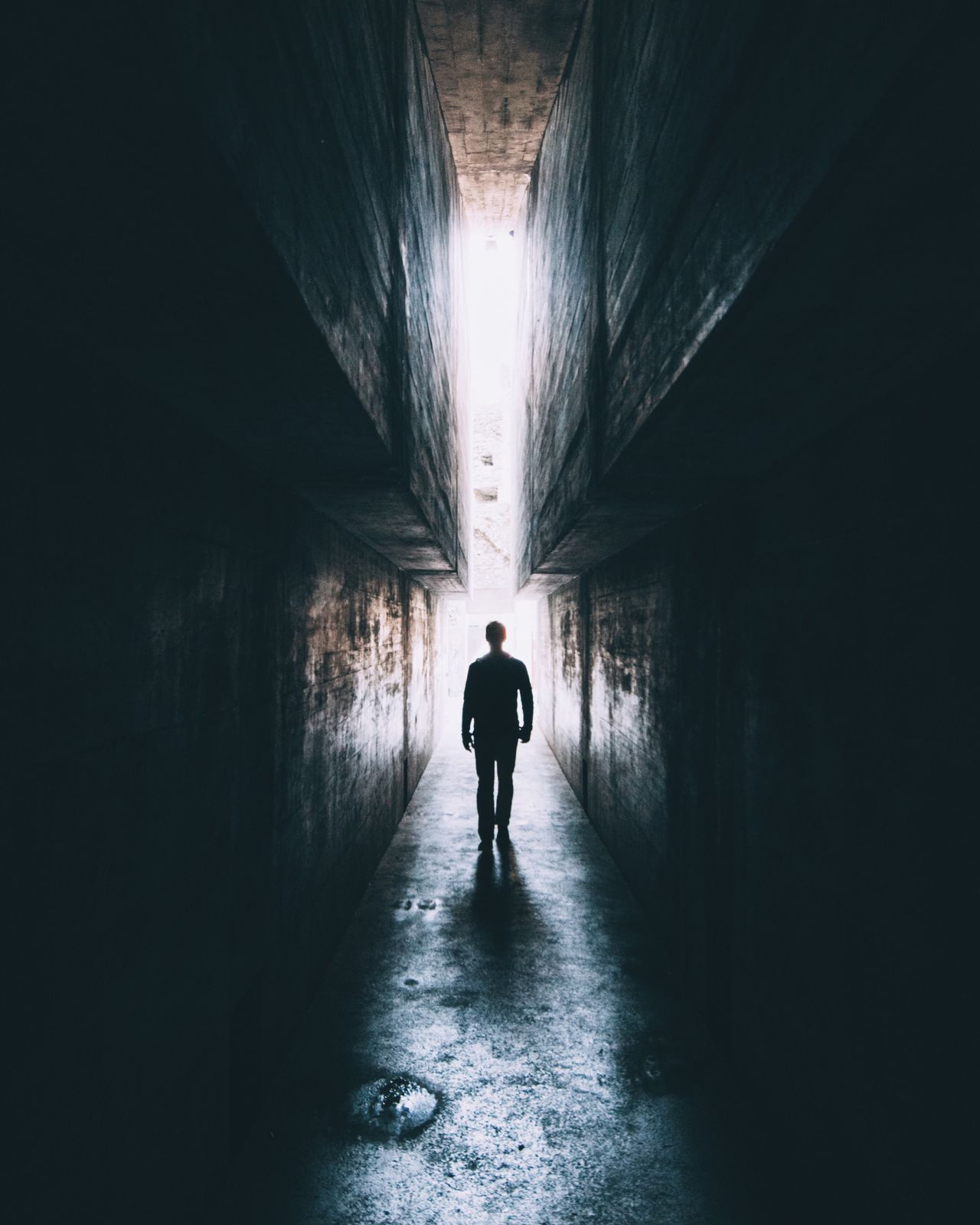Tunnel Indoors  Walking Full Length One Person Rear View Silhouette Light At The End Of The Tunnel Men Built Structure The Way Forward Architecture Real People One Man Only Lifestyles Day Adult Only Men People Light And Shadow Light Daylight Creepy Scary Mysterious The Street Photographer - 2017 EyeEm Awards