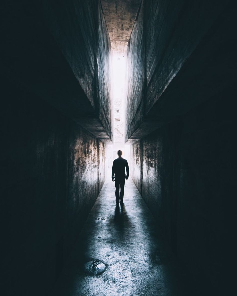 Tunnel Indoors  Walking Full Length One Person Rear View Silhouette Light At The End Of The Tunnel Men Built Structure The Way Forward Architecture Real People One Man Only Lifestyles Day Adult Only Men People Light And Shadow Light Daylight Creepy Scary Mysterious
