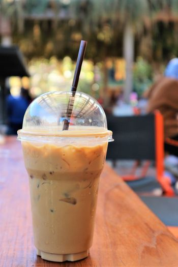 fresh ice coffee in the plastic cup on the table. Cafeine Coffee Cafe Close-up Day Drink Drinking Drinking Glass Drinking Straw Focus On Foreground Food Food And Drink Freshness Healthy Eating Iced Coffee Incidental People Outdoors Plastic Cup Ready-to-eat Refreshment Table