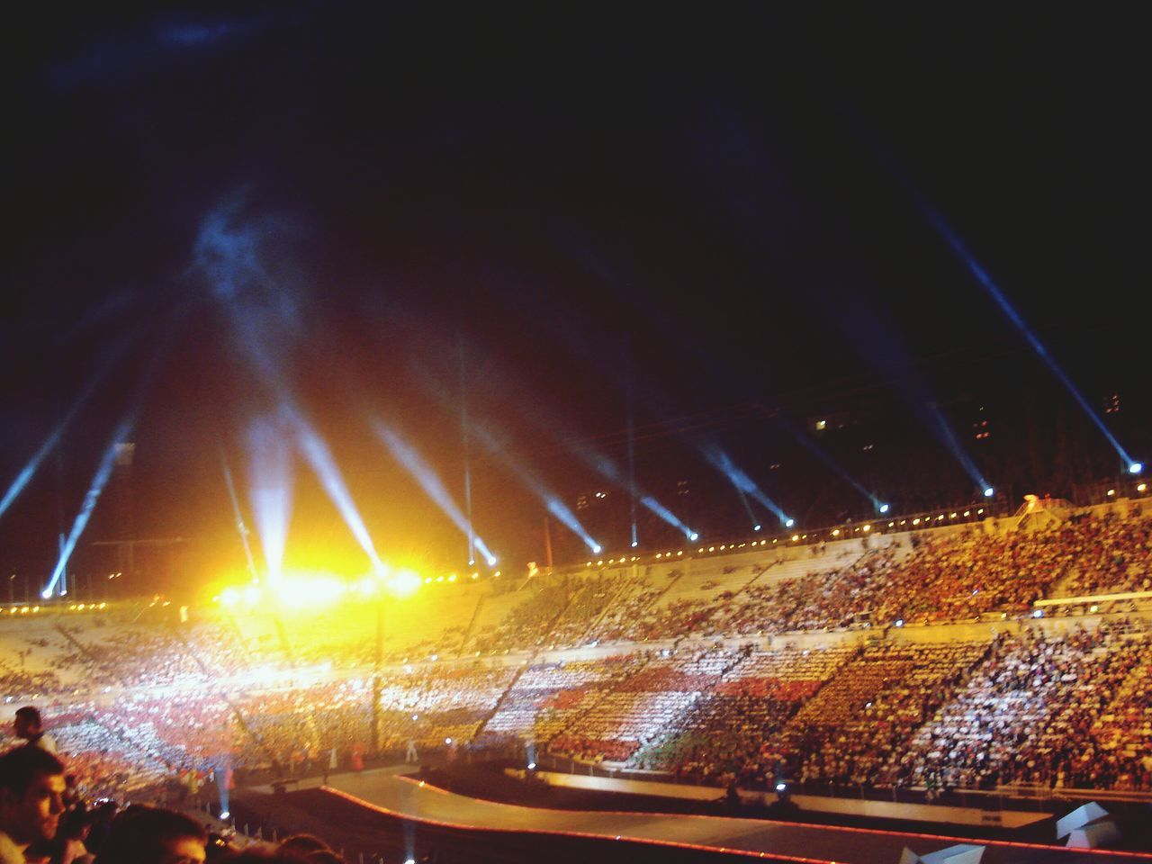 night, large group of people, illuminated, audience, crowd, real people, enjoyment, arts culture and entertainment, stage light, stage - performance space, outdoors, performance, music, popular music concert, fan - enthusiast, sky, people