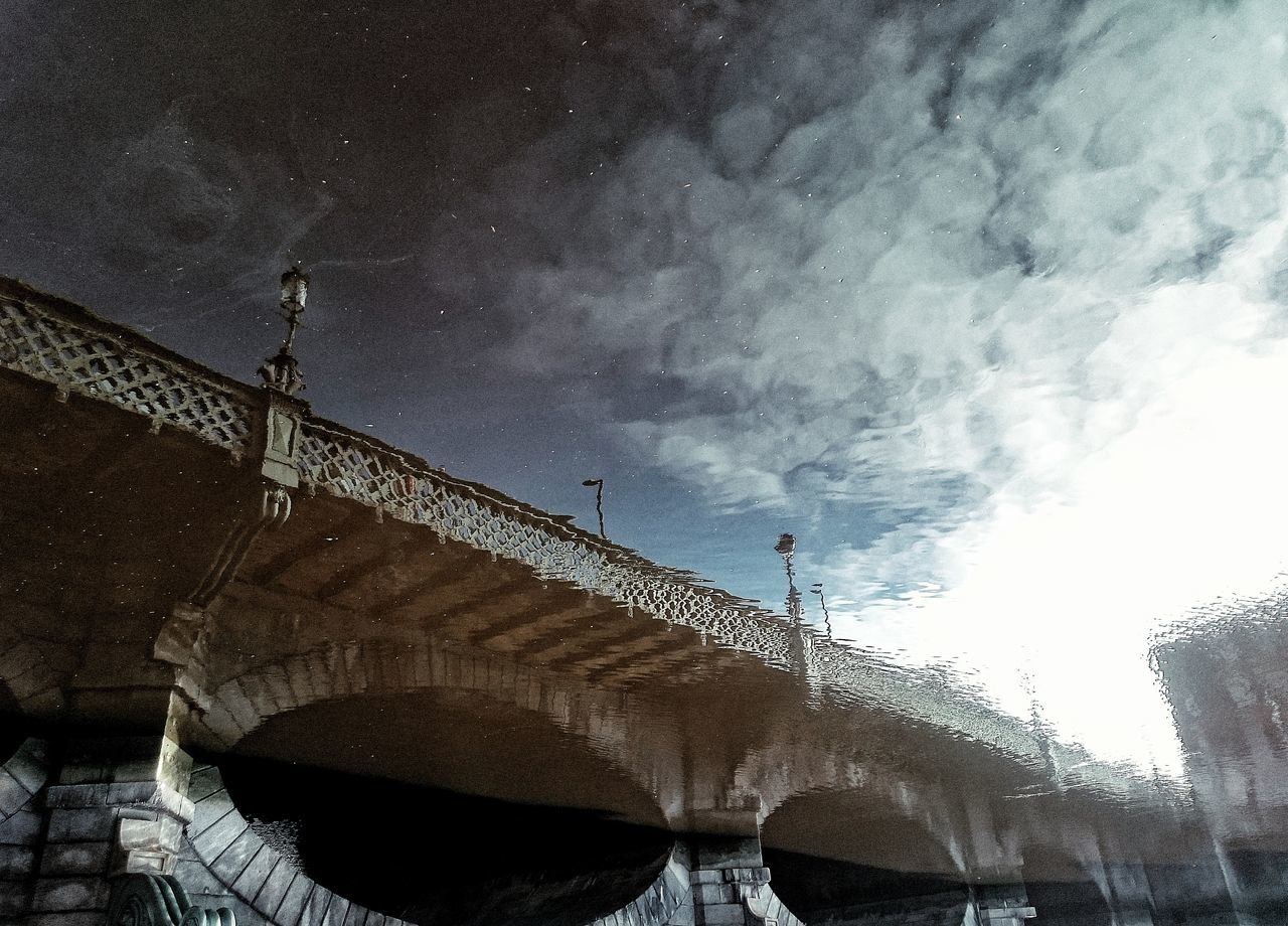 architecture, built structure, low angle view, bridge - man made structure, connection, sky, building exterior, outdoors, cloud - sky, day, no people