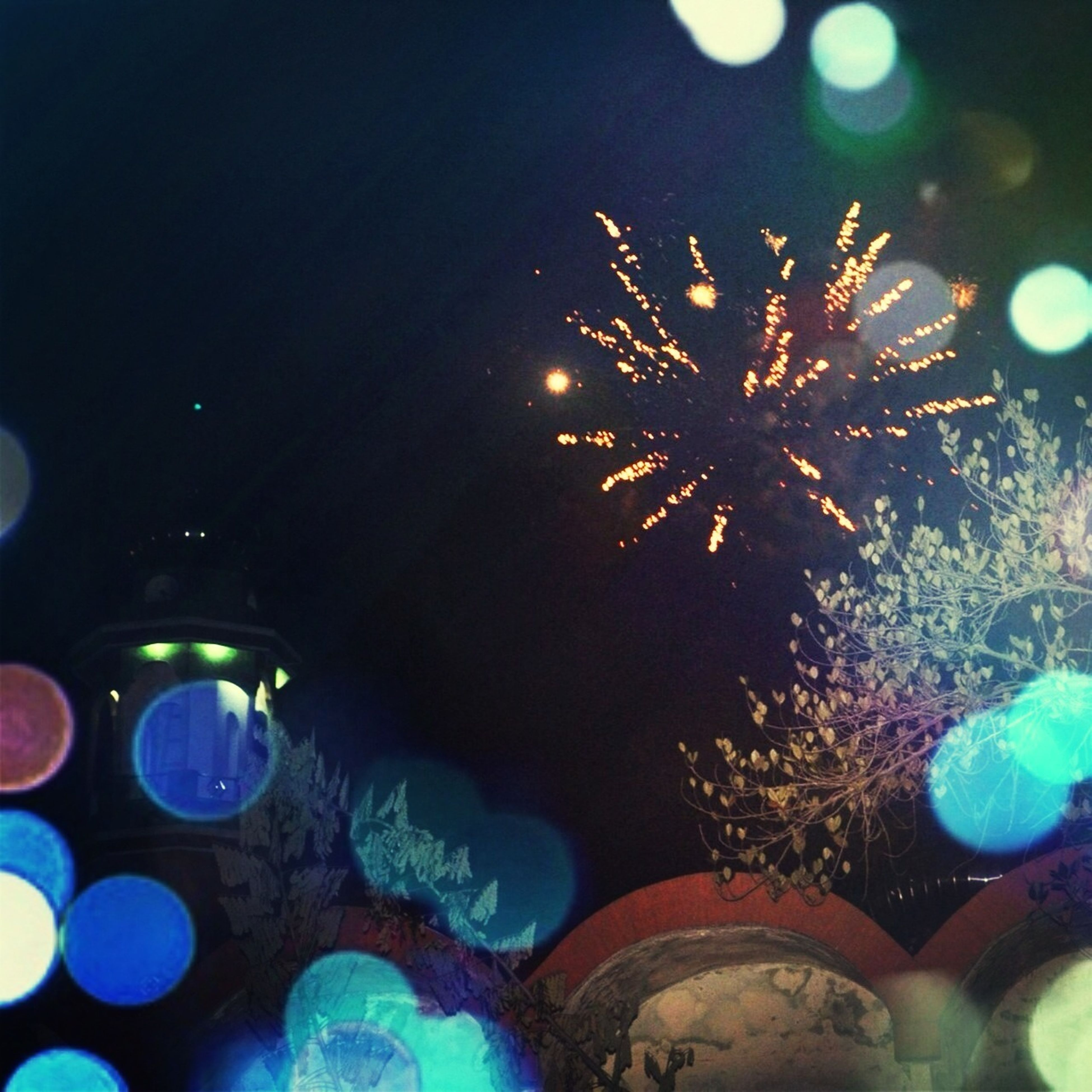 illuminated, night, glowing, celebration, lighting equipment, low angle view, multi colored, light - natural phenomenon, decoration, no people, outdoors, close-up, christmas decoration, firework display, circle, tree, exploding, arts culture and entertainment, light, long exposure