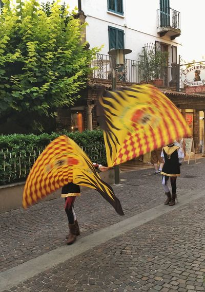 In Sirmione Umbrella Rain Protection Rear View Striped Architecture Outdoors Built Structure Full Length Building Exterior Real People Walking Sirmione Lago Di Garda Historical Procession Weather Under Day Street Women Wet City