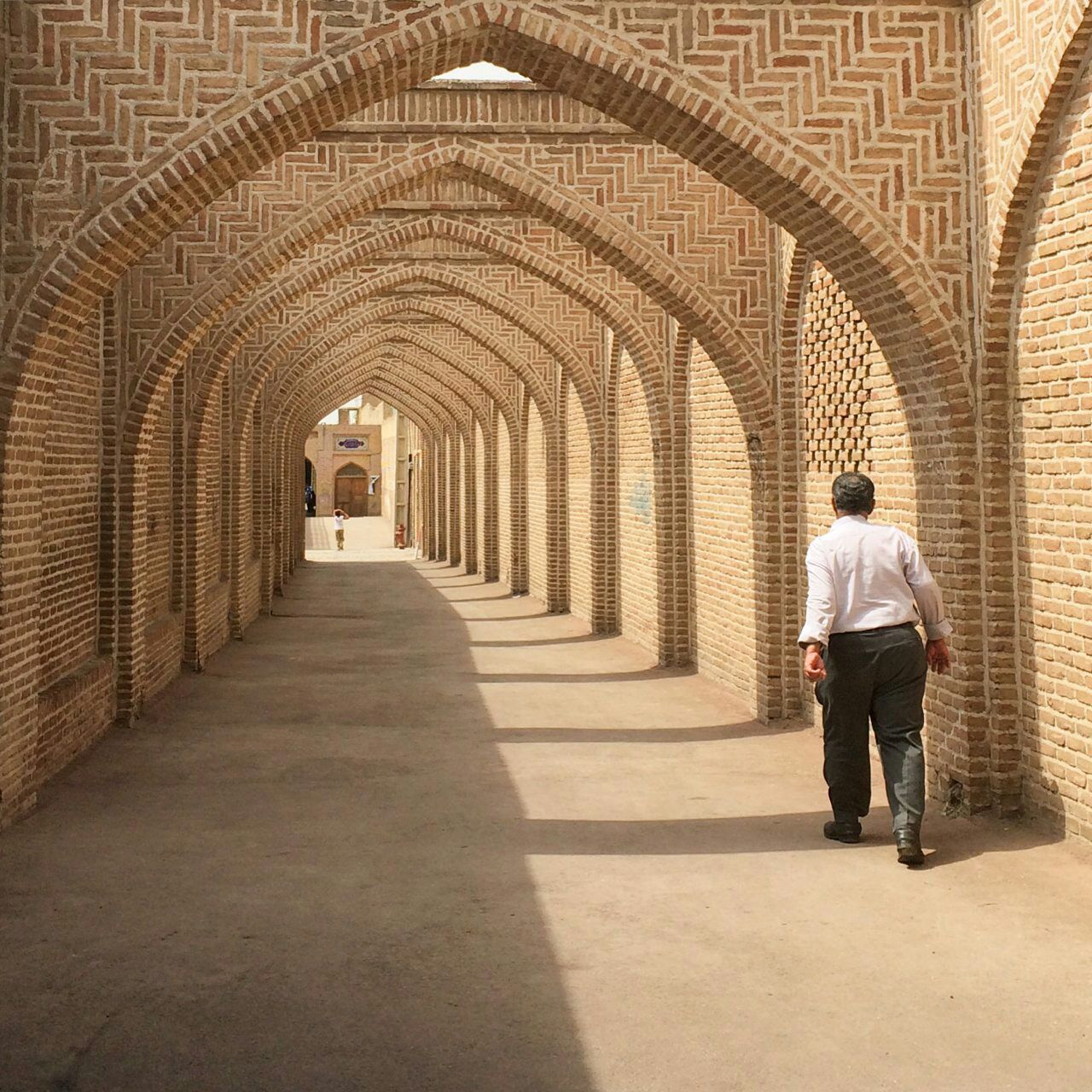 arch, architecture, history, the way forward, indoors, one person, real people, built structure, corridor, full length, architectural column, day, men, adult, people