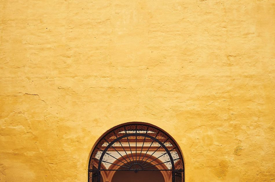 Yellow No People Architecture Built Structure Textured  Backgrounds Outdoors Close-up Day Door Arabic Building Culture Alcazar Sevilla Seville Yellow Color Yellow Wall Gate