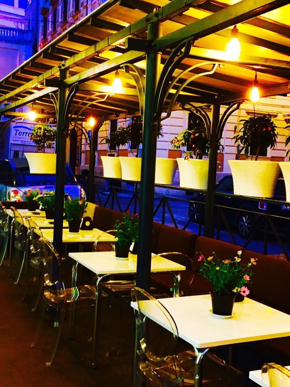 illuminated, indoors, night, in a row, chair, restaurant, table, seat, no people