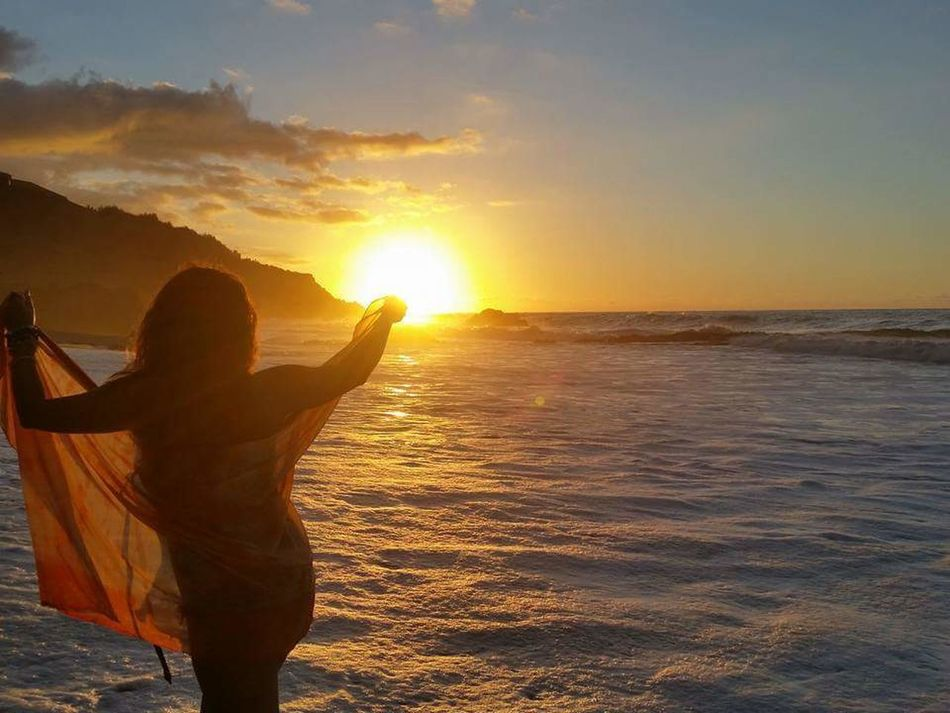 Sunset Beach Sea Photography Themes Full Length Happiness Nature Social Issues Romantic Sky Beauty In Nature Travel Destinations Vacations Outdoors Sun Horizon Over Water Portable Information Device One Person People Sand Water