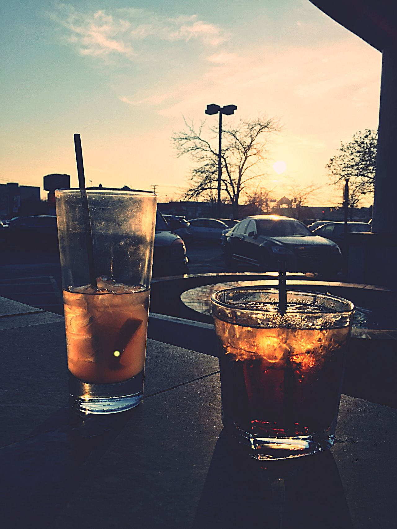 Check This Out Drinks Drinks! Hello World Out Outside Beverage Liquor Ice Ice Cube Glasses Sunset Sunset_collection Relaxing Duet Duo Togetherness Harmony Shotoftheday ShotOniPhone6 Fall Hotel Entrance Drinking Drinks With Friends