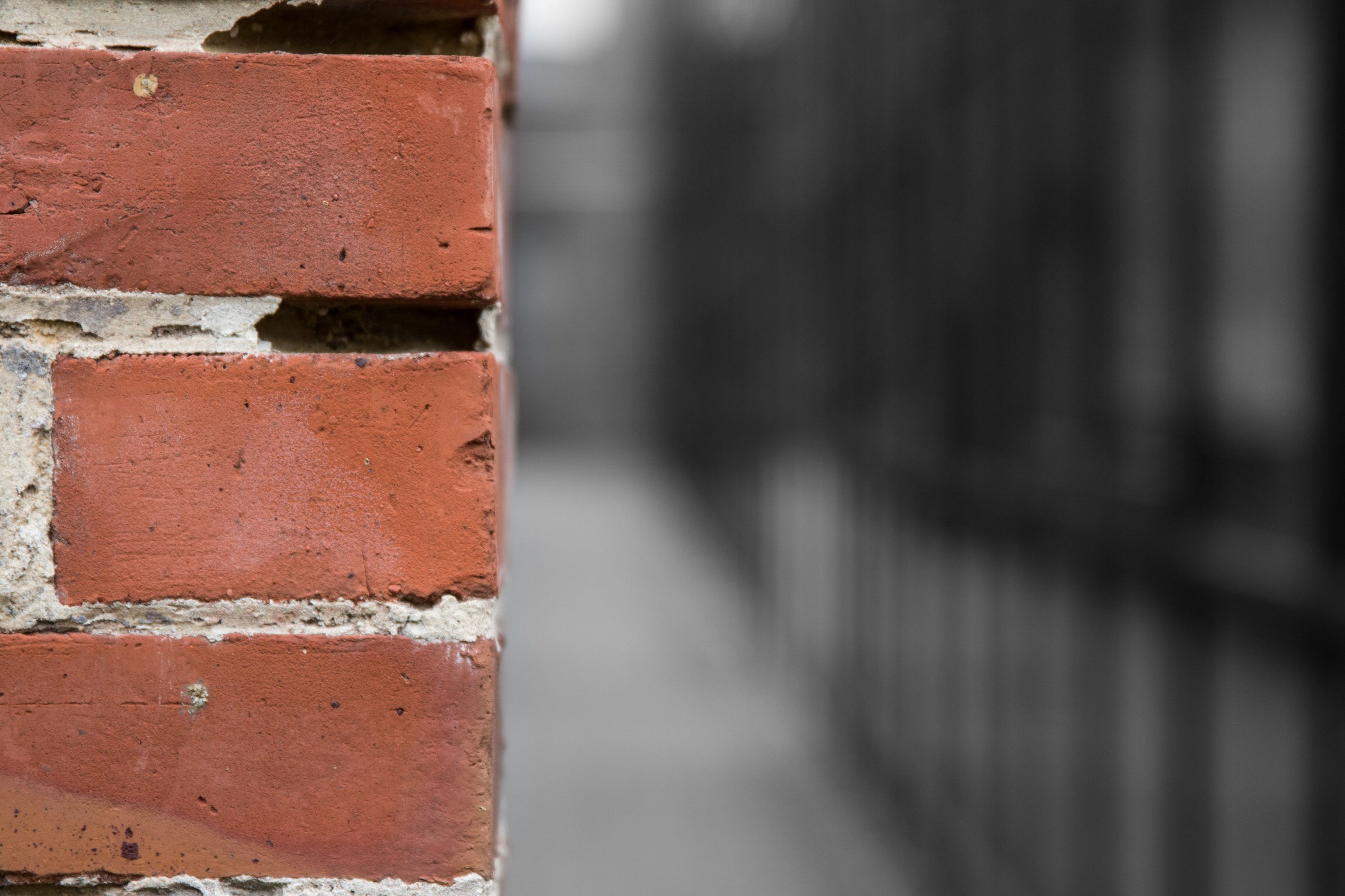 focus on foreground, architecture, built structure, wall - building feature, close-up, selective focus, brick, day, red, no people, history