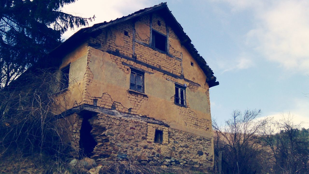 Low Angle View Of Weathered House