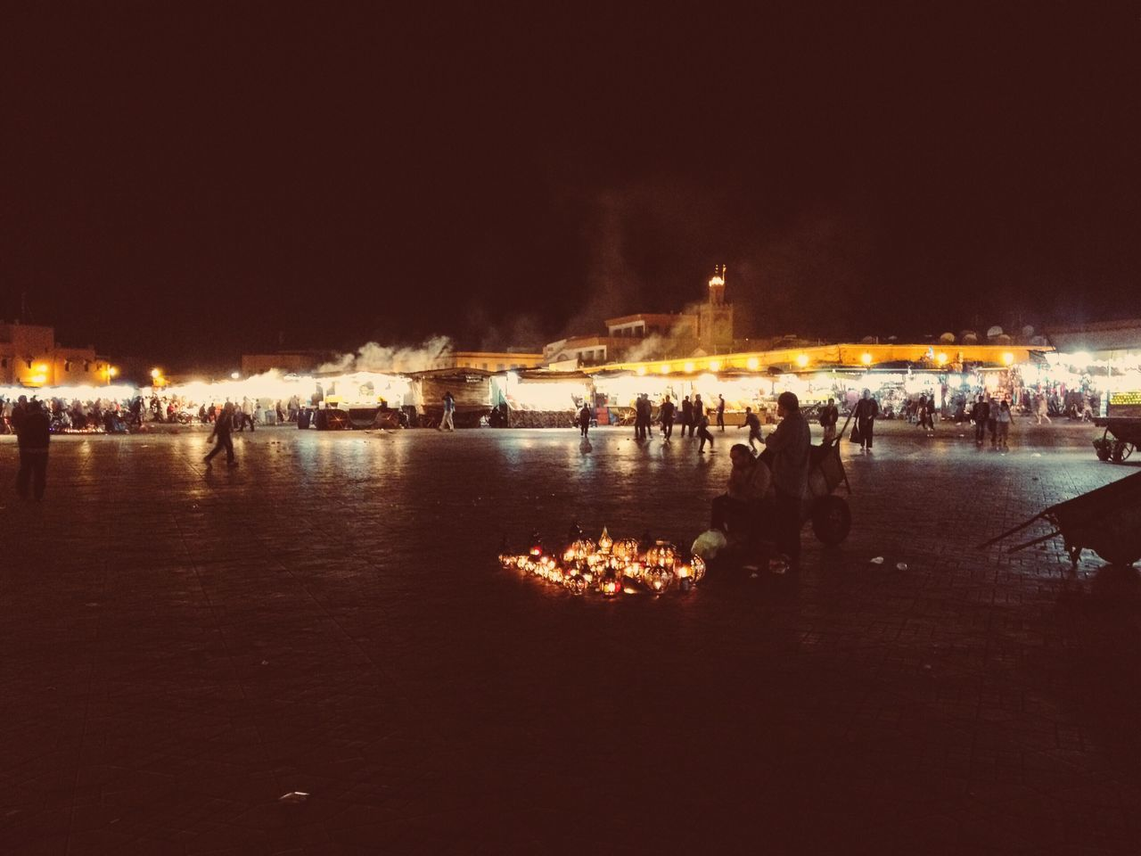 Fires in the night Illuminated Night Building Exterior Large Group Of People River Outdoors Architecture Men Sky Real People Piazza Fire Marrakech Finding New Frontiers