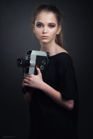 Old school cinema Studio Shot Portrait Young Adult Waist Up One Person Beauty Holding Young Women Adult One Young Woman Only One Woman Only Beautiful Woman Gray Background People Adults Only Only Women Home Video Camera Indoors