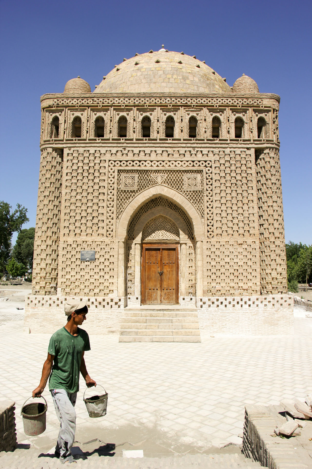 Adult Arch Architecture Building Exterior Built Structure Bukhara Clear Sky Day History Islamic Architecture Mausoleum Men One Man Only One Person Outdoors People Real People Silk Road Sky Travel Destinations Uzbekistan Young Adult