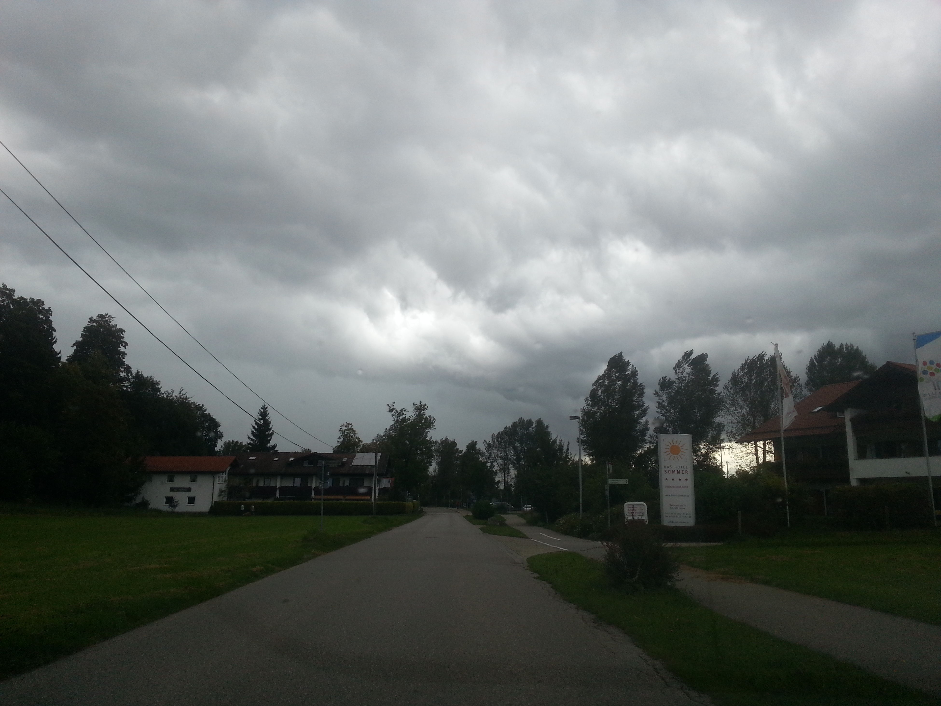 sky, cloud - sky, cloudy, building exterior, the way forward, tree, built structure, architecture, road, grass, cloud, house, overcast, weather, field, nature, storm cloud, empty, street, tranquility
