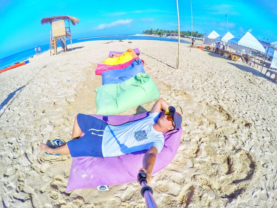 Beach Beaches, Vacation, Colour Alone, Thinking (...of You) Day Sea Sand Summer Faces Of EyeEm More Fun In The Philippines  Enjoying Life Hanging Out Everyday Lives Whitebeach Outdoors One Person Taking Photos Looking At Camera Chillin Portrait Vacations Sky Sunbathing Relaxation Water Blue