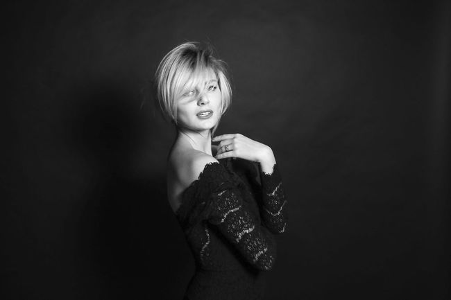 Elegant EyeEmNewHere Girl Power Attractive Beautiful Woman Beauty Black And White Black And White Photography Black Background Blond Hair Classy Fashion Model Femininity Happiness Lace Dress Lifestyles Looking At Camera One Person Portrait Real People Seductive Smiling Studio Shot Young Adult Young Women