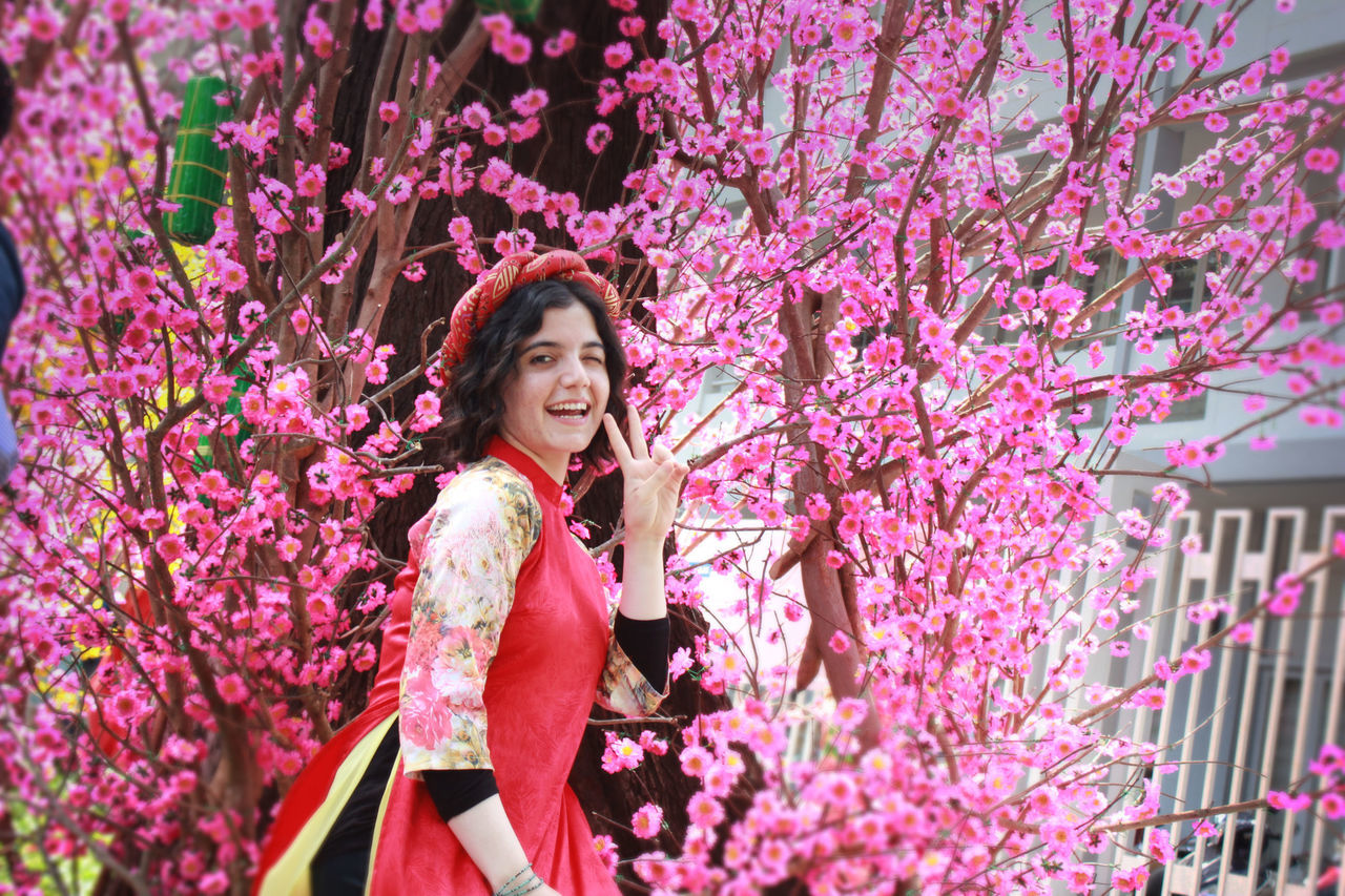 Adult Adults Only Arts Culture And Entertainment Beautiful Woman Beauty Cheerful Decoration Flower Happiness Long Hair One Person One Woman Only Only Women People People Watching Portrait Smiling Tet 2017 Tet Holiday Tet In Saigon Tetholiday Tết Vietnam Vietnamese Vietnamesegirl