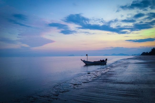 A lonely fishing boat at the end of the day.