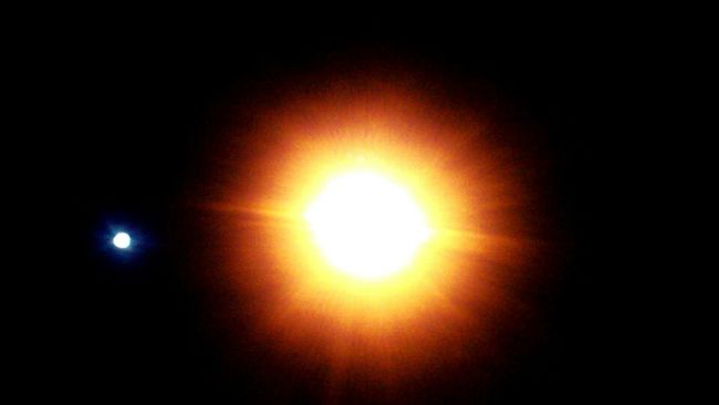 The Moon Beside A Light