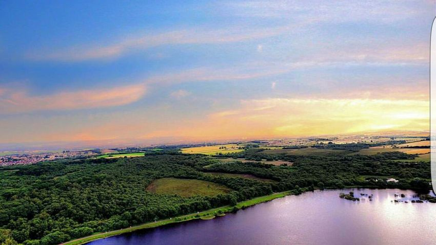 A Bird's Eye View Water Water Sunset Sky Tranquil Scene Cloud - Sky Tranquility Scenics City Orange Color Beauty In Nature Waterfront Nature Distant Blue Tourism Canal Outdoors Vacations Aerial View Day
