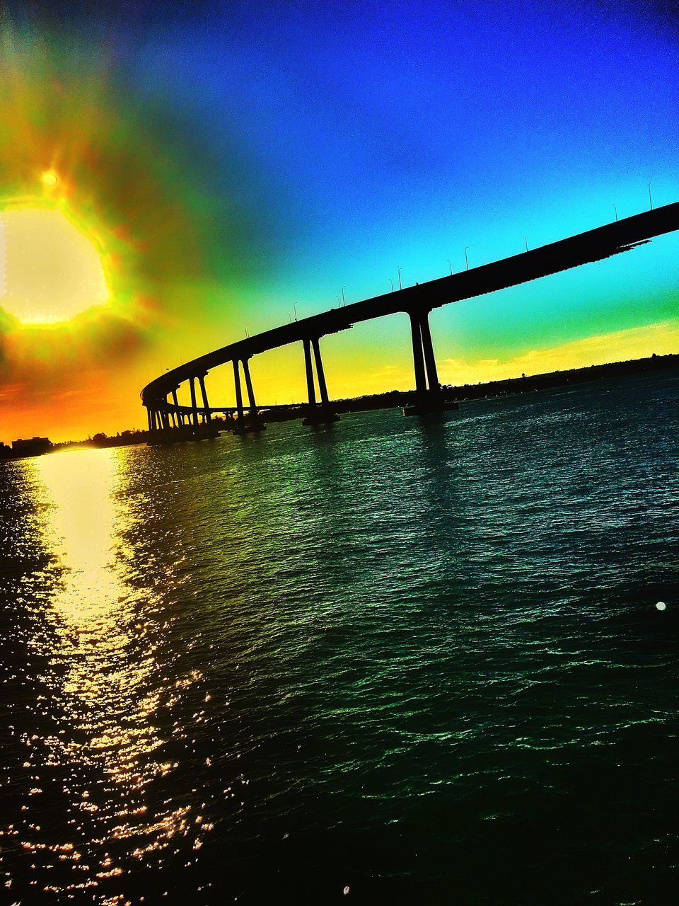 bridge - man made structure, sunset, connection, built structure, water, sky, architecture, transportation, nature, outdoors, river, silhouette, tranquility, no people, sunlight, travel destinations, beauty in nature, scenics, day