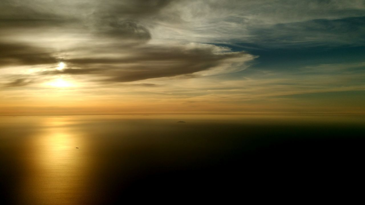 From An Airplane Window Sun Setting Great Landscape Hakata Bay Fukuoka,Japan Sky And Clouds Landscape