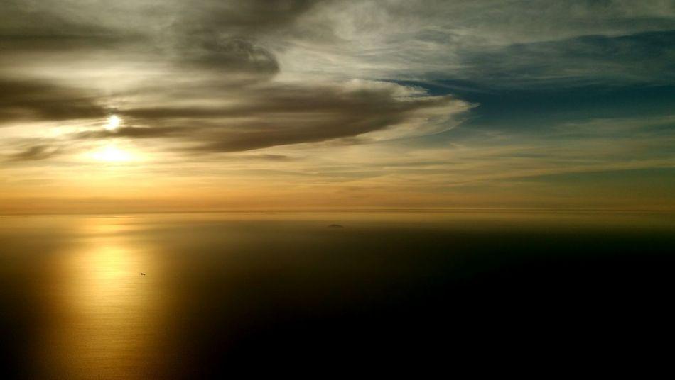 From An Airplane Window Sun Setting Great Landscape Hakata Bay Fukuoka,Japan Sky And Clouds Landscape