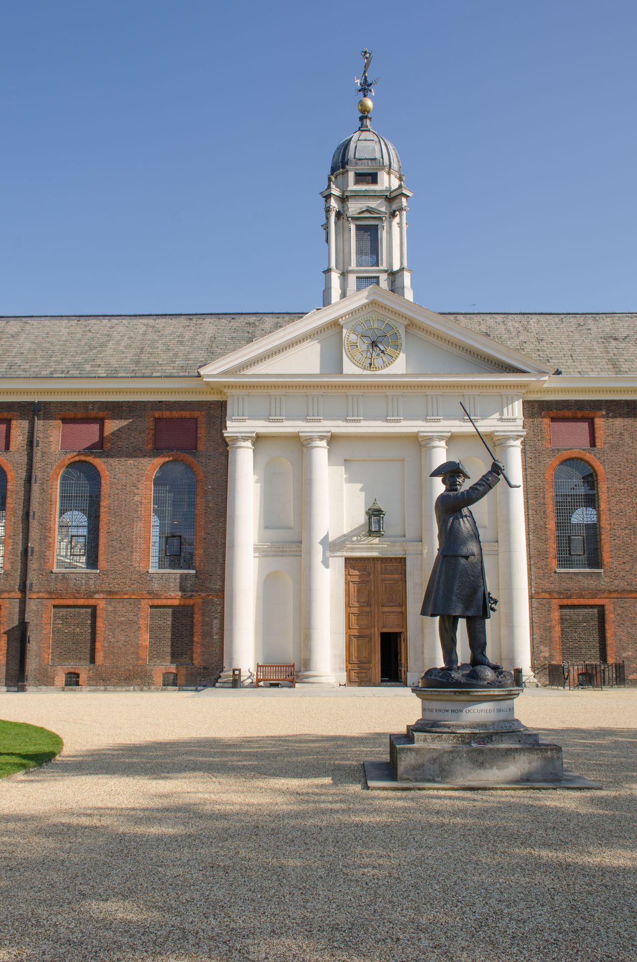 Front of Royal Chelsea Hospital with pensioner statue at entrance Architecture Architecture Building Exterior Built Structure Chelsea Chelsea Hospital Christopher Wren Door Façade Front View Grand Outdoors Statue Veterans War Wren