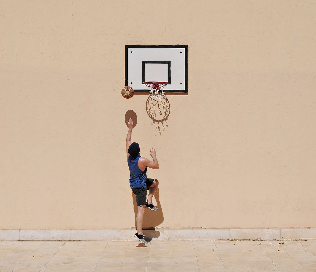 arid climate basketball - sport Basketball hoop Copy Space EyeEmNewHere full length healthy lifestyle high wall leisure activity light and shadow Males one person outdoors people playing Rear view Reflection simplicity