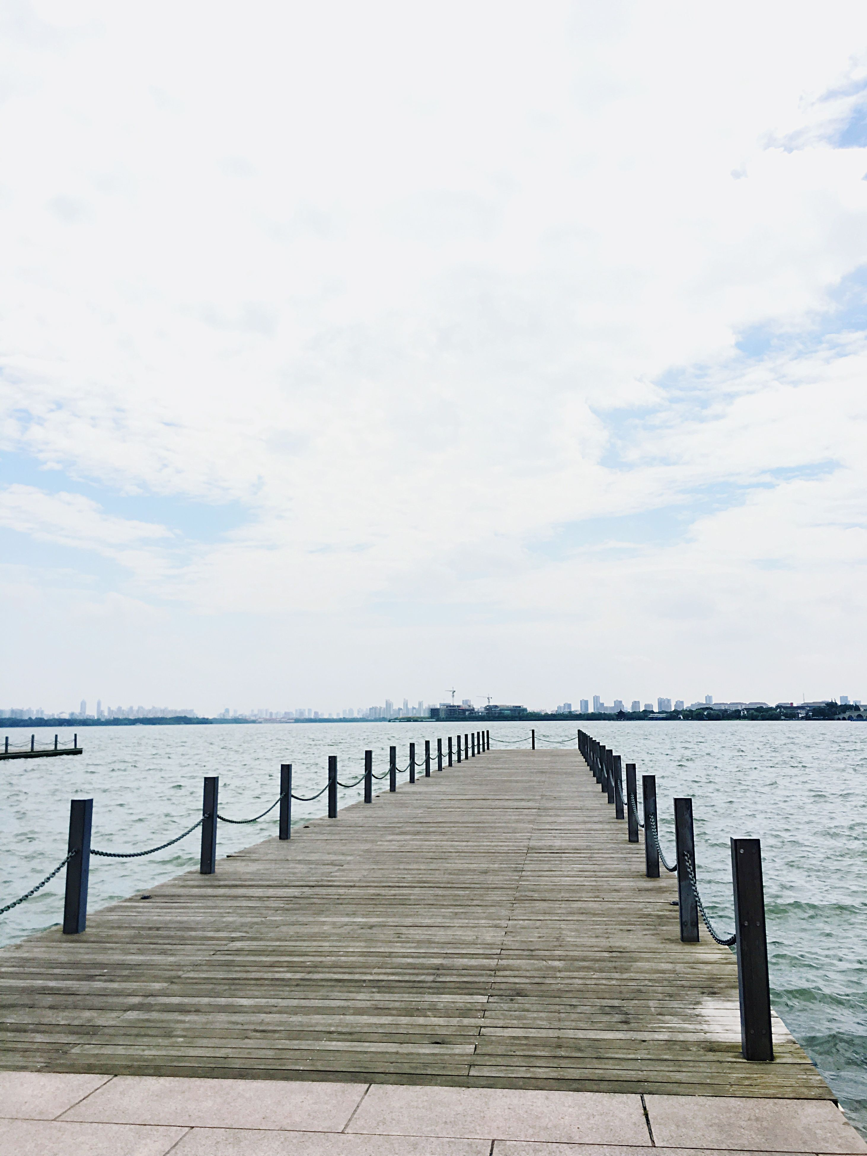 water, pier, sea, the way forward, tranquil scene, tranquility, sky, jetty, scenics, railing, beauty in nature, horizon over water, wood - material, nature, diminishing perspective, boardwalk, idyllic, long, calm, wood