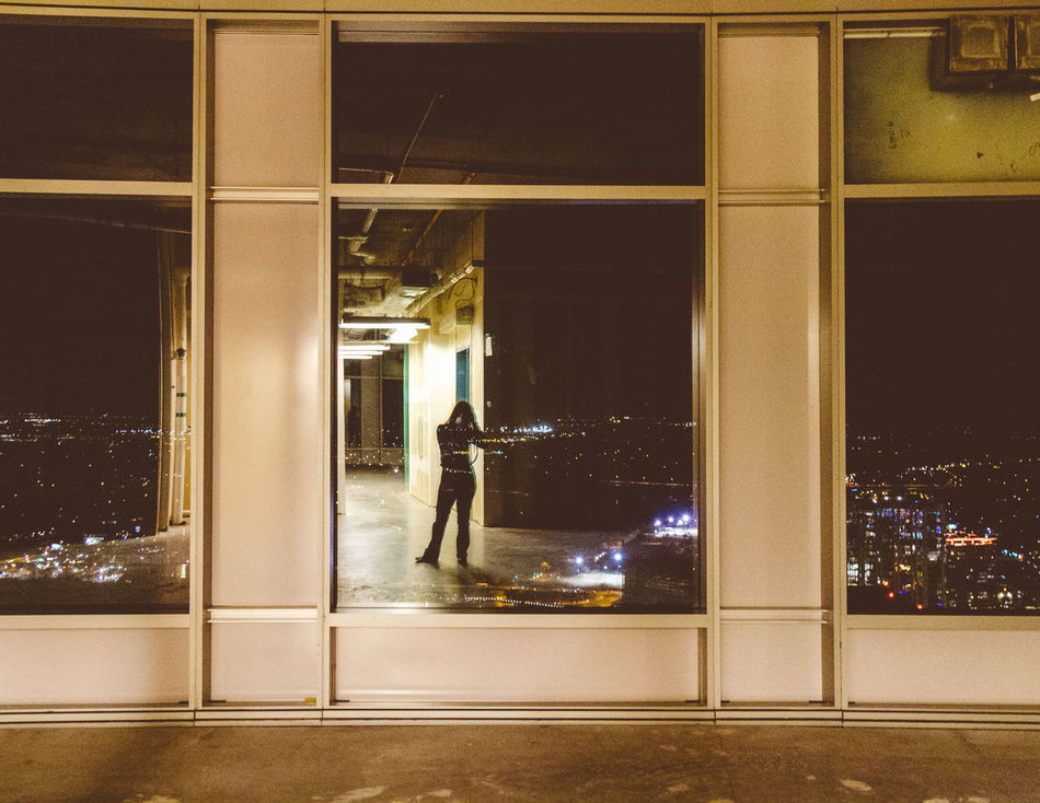 Alone City Life Dark High Rise Silhouette Solitary Adventure Architecture Built Structure City Empty Flat Fresh Illuminated Independent  Indoors  New Beginning Night One Person Real People Window
