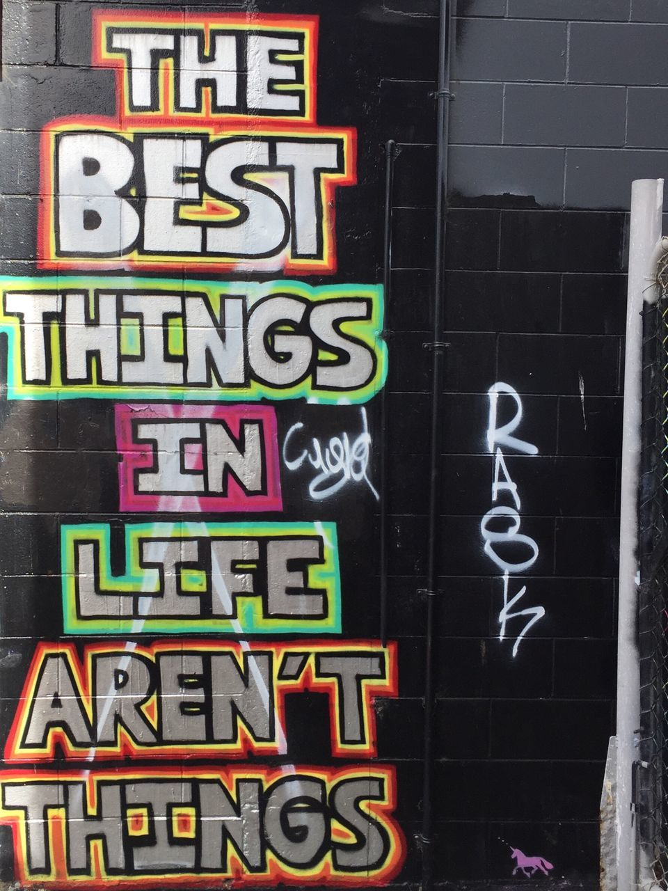 text, multi colored, no people, building exterior, outdoors, communication, day, architecture, alphabet, blackboard, neon, close-up