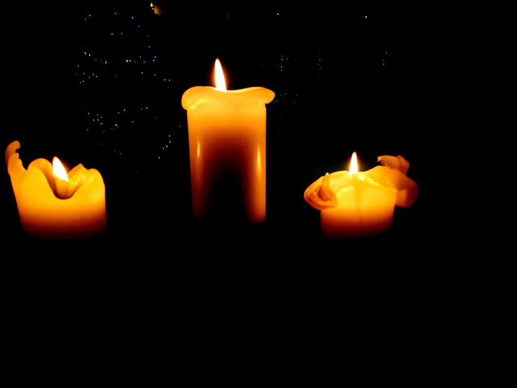 Candles in the wind Flame Candle Burning Candlelight Glowing Illuminated Wax No People Indoors  Close-up Three Candles Dark Dark Room