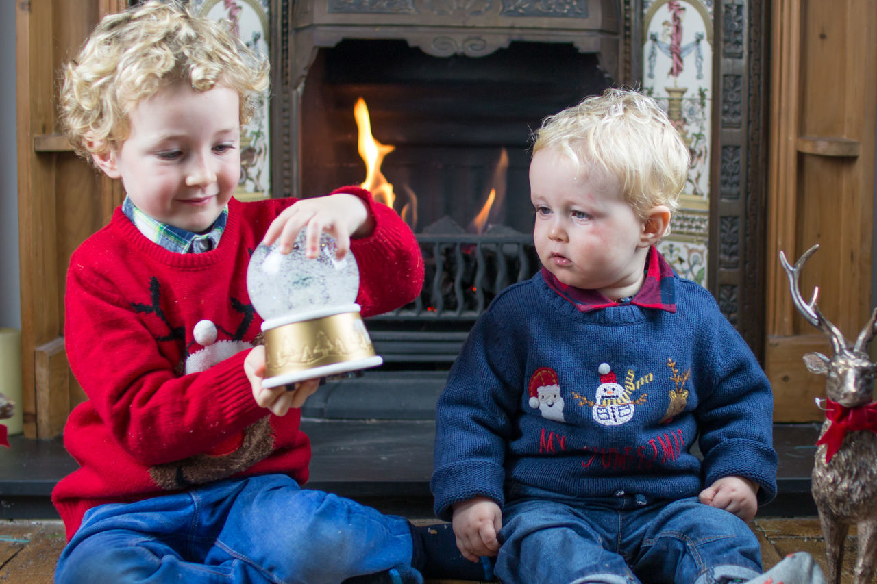 How's it work bruv? Boys Brothers Childhood Christmas Christmas Christmas Fun Cute Cute Christmas Day Fireplace Joy People Portrait Snow Snow Globe Streamzoofamily Warming Fire Winter Winter Winter Joy Winter Wonder