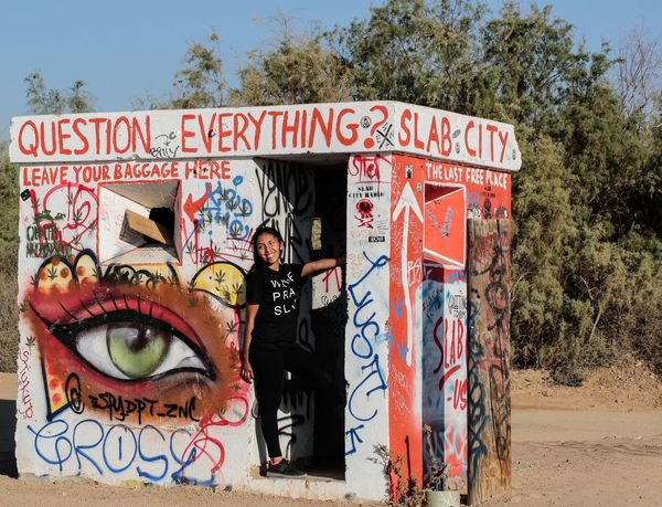 """Entrance to Slab City. Slab City calls itself """"the last free place on earth."""" No rent, no fees, no rules, no inspections. A community of people living for self expression and solitude in the California Desert a few miles southeast of the Salton Sea, near Niland, CA. California Desert California Love Niland Slab City Folk Art  Public Art Visionary Art Colorful Buildings Desert JGLowe Deserts Around The World Desert Beauty Desert Life Freedom Of Expression No Rules"""