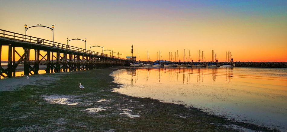 Sunset Water Transportation Built Structure Architecture Clear Sky Reflection Travel Destinations Scenics Tranquility Distant Tourism Sky Outdoors Orange Color Tranquil Scene Engineering No People Vacations Architecture Beauty In Nature Romantic Sky Majestic Tranquility Bridge - Man Made Structure