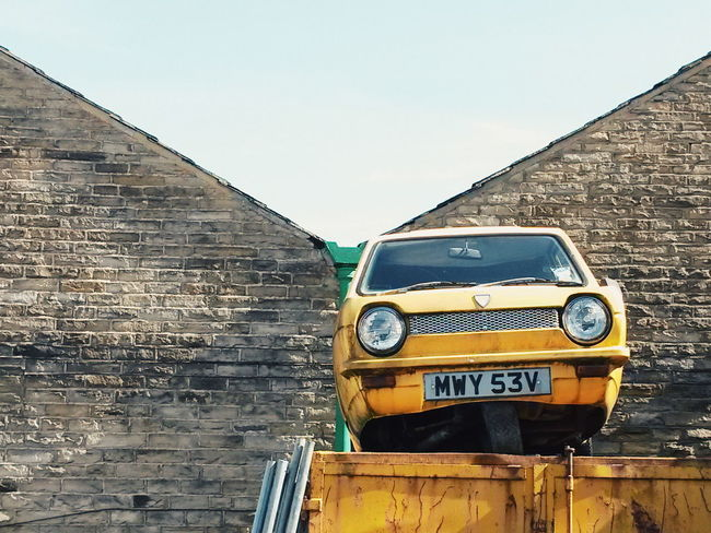 Robin Reliant on Roof Robin Reliant Rooftop Junk Scrap Britain Transportation Streetphotography Clear Sky No People Outdoors England Street Camera Building Exterior Vintage Europe