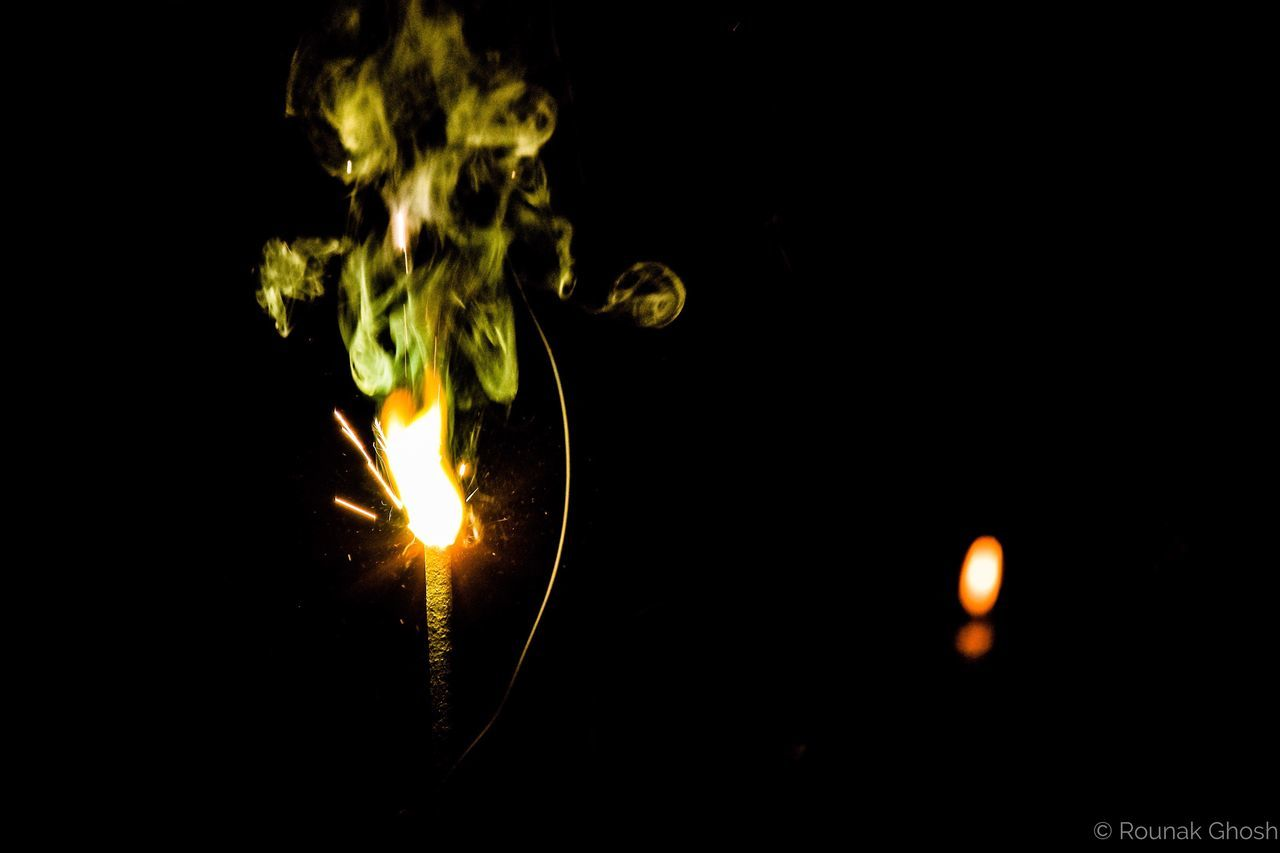 burn the evils...burst them into colors Lighting Equipment Illuminated Glowing Yellow Low Angle View Close-up Flame No People Night Black Background Filament Crackers Celebration Good And Evil Lights And Shadows Lights In The Dark Green Color Green Smoke Lights And Smoke Glowing In The Dark Check This Out Burning Sparks Trails